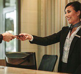 Women, booking a room in Hotel through travel agency